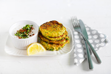 Vegetarian lunch of zucchini fritters with coconut yogurt