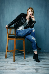 Woman in a leather jacket