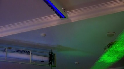 Green laser beams in an artificial fog (DJ lighting  )