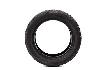 Front view studio shot of a single car tire