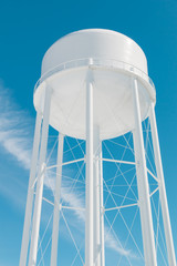 Water tower against blue sky