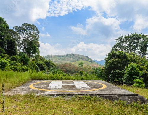 Helicopter landing pad on mountain - 80972310