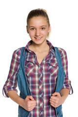 Blonde teen girl against the white