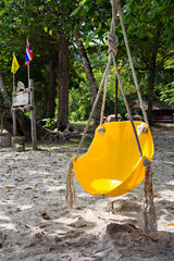 yellow swing on the beach