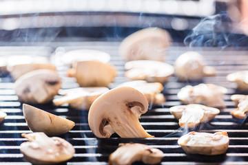 Champignon mushrooms on grill