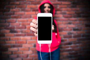 Woman showing blank smartphone screen