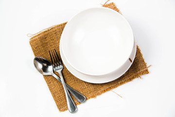 Place setting of dishes on white