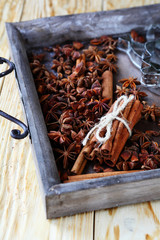 Cinnamon and anise in wooden tray