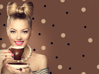 Beauty fashion model girl drinking coffee or tea