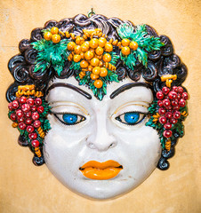 Woman face typical Sicilian glazed ceramic, Italy.