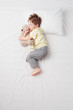 canvas print picture - Top view of little boy sleeping in Foetus pose