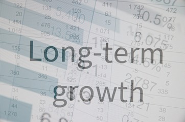 "Inscription ""Long-term growth"". Corporate earnings concept."
