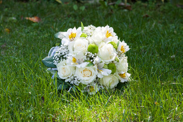 wedding bouquet from rose, freesia and eustoma