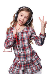 Pretty little girl singing in imaginary microphone with
