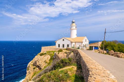 Foto op Plexiglas Vuurtoren / Mill Lighthouse on cliff edge, Cala Ratjada, Majorca island, Spain