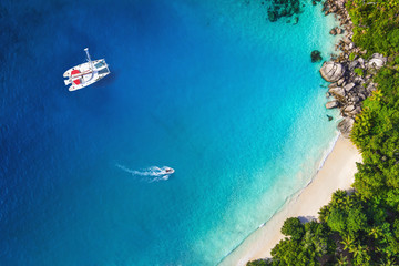 Amazing view to Yacht in bay with beach - Drone view. Birds eye