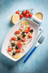 octopus salad with cherry tomatoes and black olives
