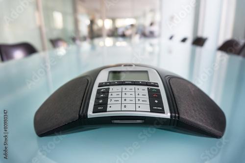 Leinwanddruck Bild Inside modern conference room, focus on phone