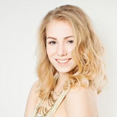 Smiling Fashion Model. Woman with Makeup and Hairstyle