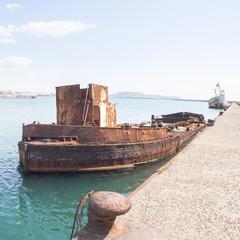 Rusty wreck moored