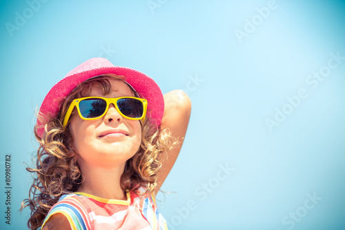Leinwanddruck Bild Happy child on summer vacation