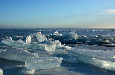 Hummock on the frozen sea shore. Sunny day