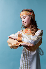 Portrait of adorable girl dancing in folk costume