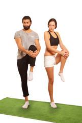 Fitness couple leg stretch exercise