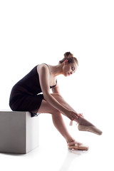 Charming young dancer puts on pointes