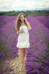 Beautiful girl with a thoughtful look on a lavender field