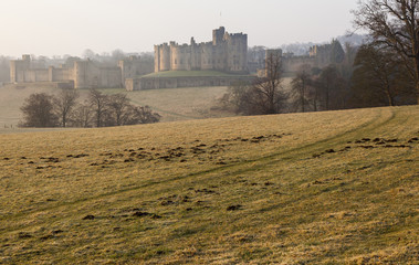 Alnwick Castle, Northumberland at dawn on a misty morning.
