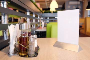 Bottles with olive oil, vinegar, salt and pepper,