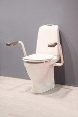 Toilet for invalids isolated under the white background