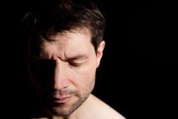 Pensive/Meditating Man In Shadow