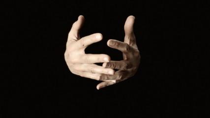 Hands closing zipper