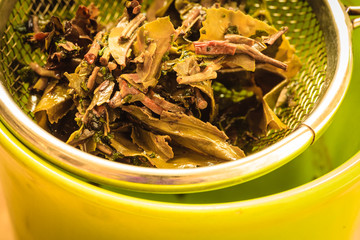 Close up tee strainer with herbal leaves