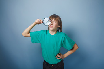 teenager boy brown European appearance in a green T-shirt put hi