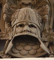 military heraldic mask bas relief