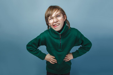 European-looking boy of ten years in glasses poses face shows to