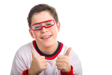 Soft skinned boy wearing red goggles makes success sign