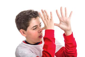 Soft skinned Latin child thumbing his nose