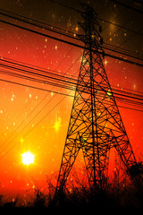 High voltage pole with sunset in front of the galaxy