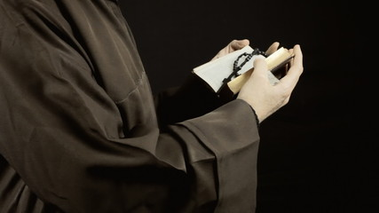 Friar reading holy book static