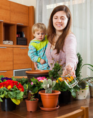 Mother and baby with flowering plants