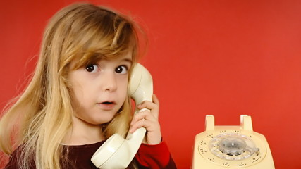 Little girl vintage telephone answer