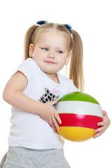 Beautiful chubby little girl holding a ball
