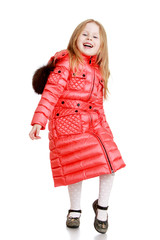 cheerful little girl in a red quilted coat