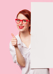 girl in white shirt and glasses with white board