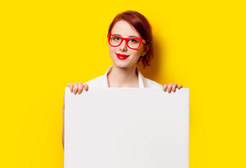 girl in shirt and glasses with white board
