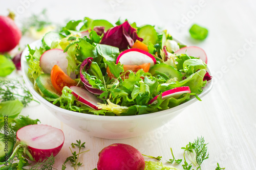 Tuinposter Voorgerecht Healthy salad with fresh vegetables and ingredients on white bac